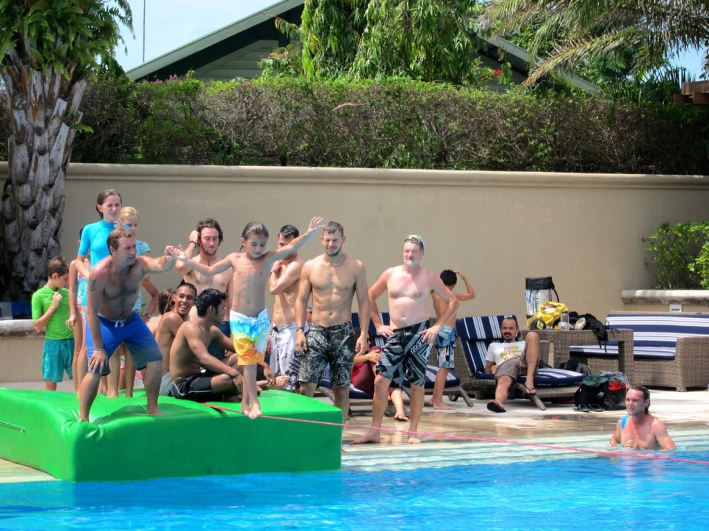 Slackline party over a swimming pool